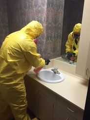 biohazard team cleaning sink